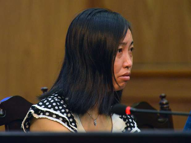 Tang Hui durante o julgamento em Changsha, na província de Hunan, nesta segunda-feira Foto: AFP