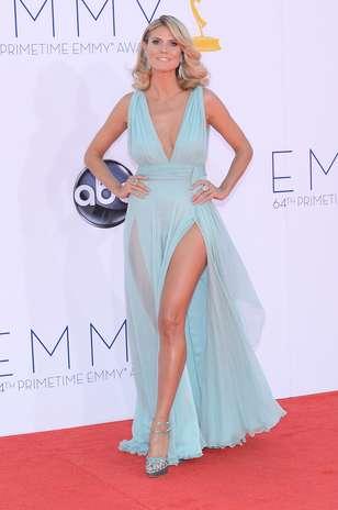 Heidi Klum fez a Angelina Jolie e apostou nas fendas profundas e na transparências. O vestido assinado por Alexandre Vauthier valorizou as longas pernas da modelo, mas deixou os seios levemente caídos e não afinou a silhueta Foto: Getty Images