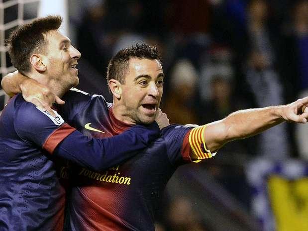 Messi e Xavi fizeram os dois primeiros gols do Barcelona no jogo Foto: EFE