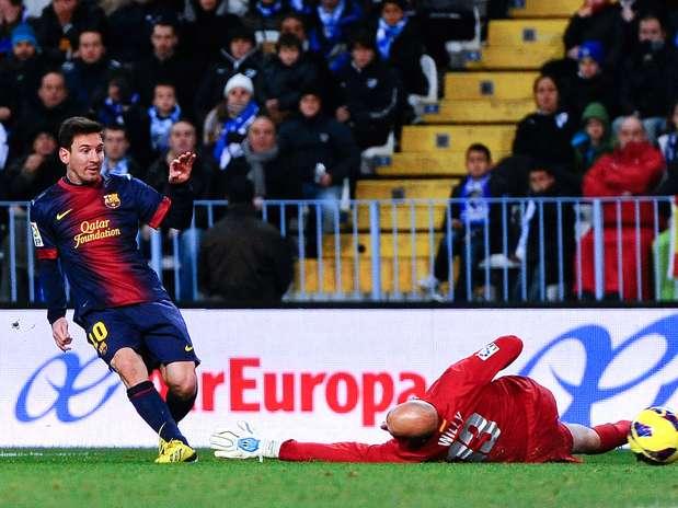 Após trabalhada da defesa do Málaga, Messi abriu caminho para vitória do Barcelona Foto: Getty Images