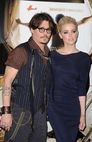 Johnny Deppe e Amber Heard à época da divulgação do filme 'Diário de um Jornalista Bêbado', em 2011 Foto: Getty Images