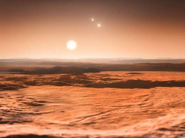 Impressão artística mostra uma vista do exoplaneta Gliese 667Cd em direção à sua estrela progenitora Foto: ESO/M. Kornmesser / Divulgação